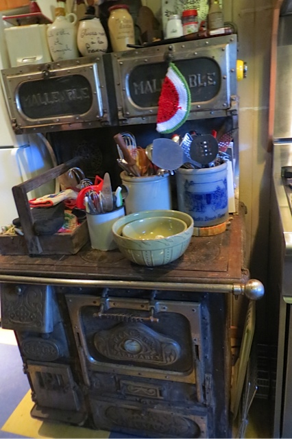 an old stove sat next to a modern one.