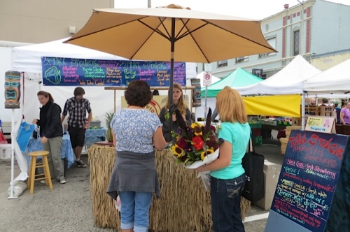 the cute Tiki Juice booth; sometimes they come to the Ilwaco market