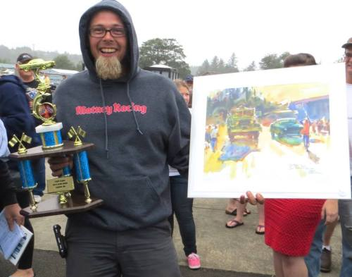 he also won a painting, a plaque, and a basket of local goodies