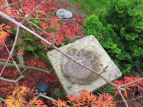 This birdbath looks perfect, much more than a round one would.