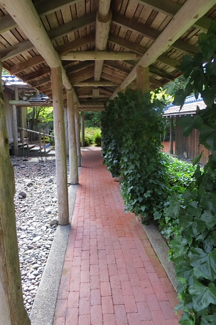 walkway from guesthouse, looking south to front porch