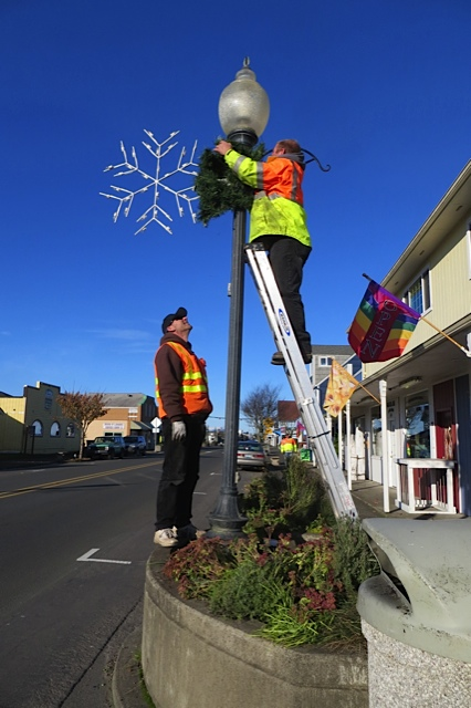 intense blue sky as city crew puts up decorations