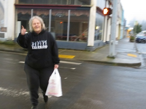 a ghostly photo of café regular Linda crossing the street to the Café