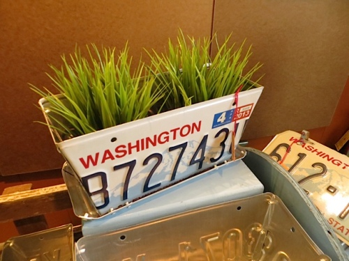 and a license plate planter by the same man