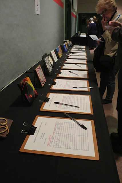 the silent auction, one of four tables