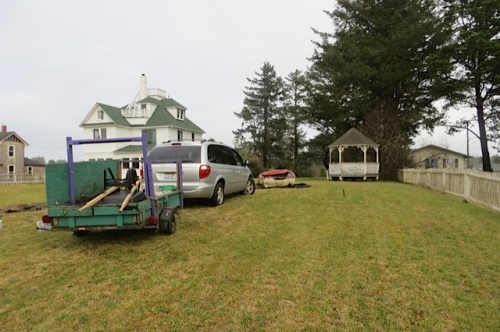 the van and trailer in the big yard