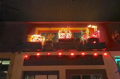 above the front door: train lights and old luggage