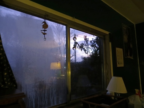 In reality, it is like this (slightly after dusk) with one window blown with moisture.