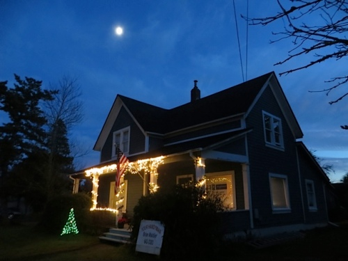 moonrise over Christmas lights on Spruce and Eliza