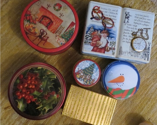 The Christmas tins sit under the tree during the season for extra decor.