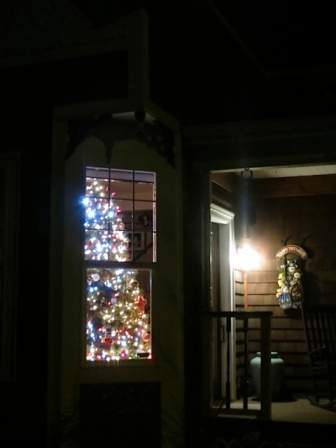 tree in the window of their 1890 house