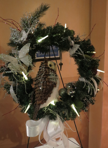 Jenna's wreath with owl and icicle lights.