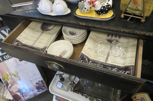 dishes displayed in drawers