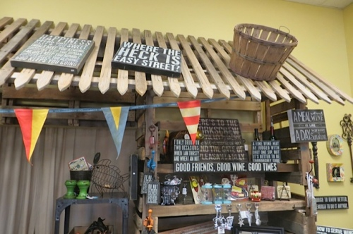 I love the shelving made of pallets and picket fencing.