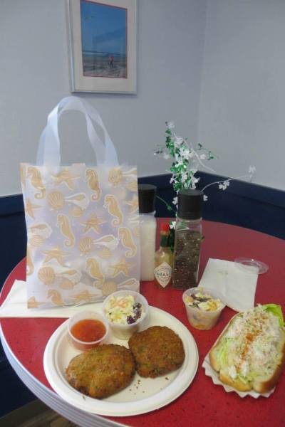 crab cakes and crab roll, delicious! with gift bag from M&D