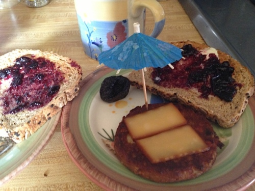 breakfast (vegetable patty with cheese, a dried plum (nice words for prune) and Dave's Killer Bread.