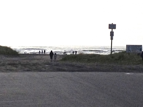 just past the westernmost planter, tourists head to the beach
