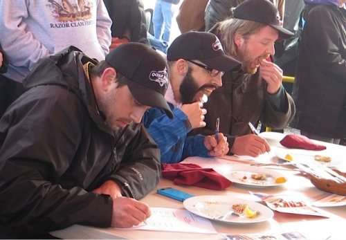 The judges considering the entries...