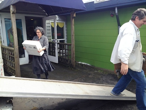 The owners of Heidi's Inn, Ilwaco, pitching in.