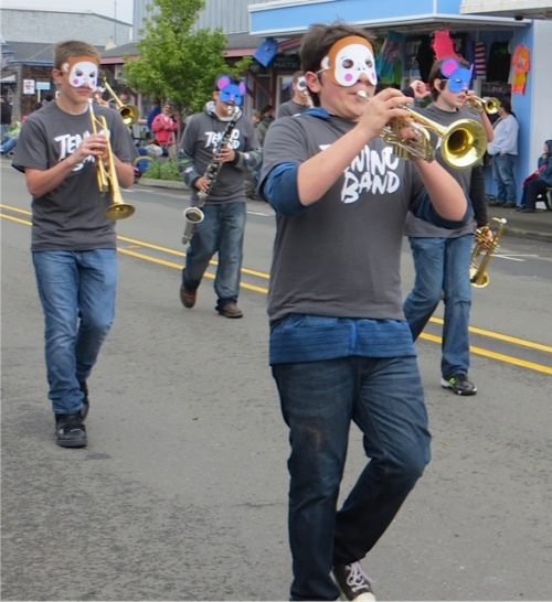 The marching band from Tenino all had animals masks.