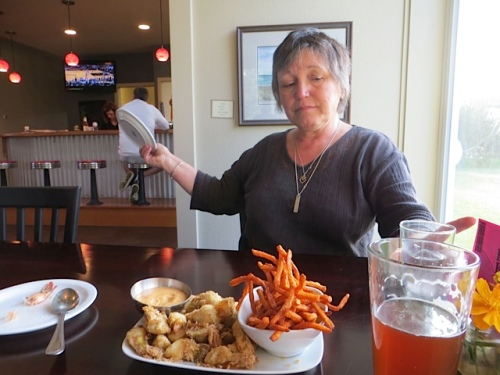 J9 helps stage the blog photo of the scrumptious fried artichoke with cajun dip appetizer