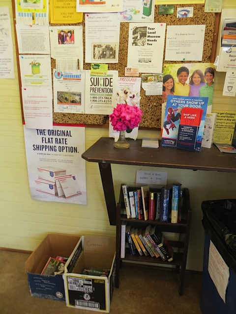 Next door to the café in the same building is the post office, with a little lending library.