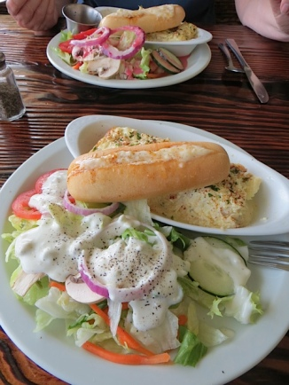 crab quiche and cheesy bread and salad