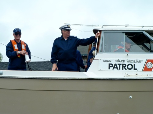 Coast Guard Auxiliary in their parade boat.