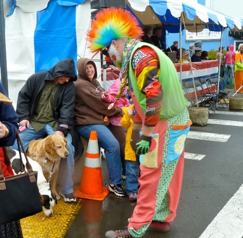 Allan's photo sequence: One clown was giving treats to dogs.