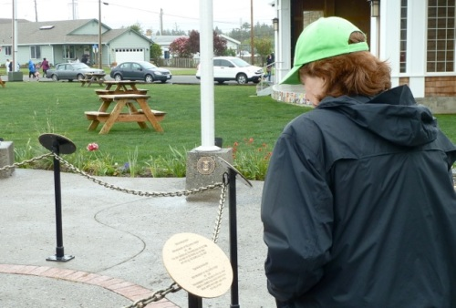 Allan's photo: a woman reading one of the plaques at Veterans Field