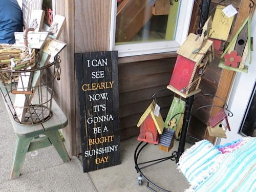 As the weather lightened up a bit:  sign outside The Wooden Horse gift shop