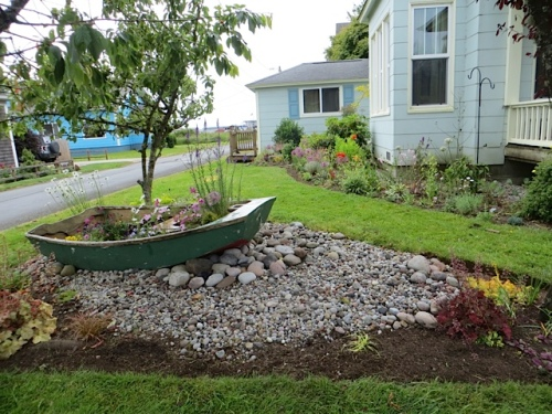 Allan put a nice edge on the boat garden bed.