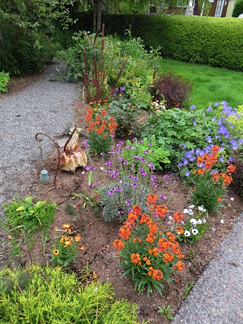 The front border has transformed from perennials to a mix with annuals.