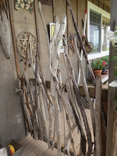 She decorated this porch gate with driftwood.