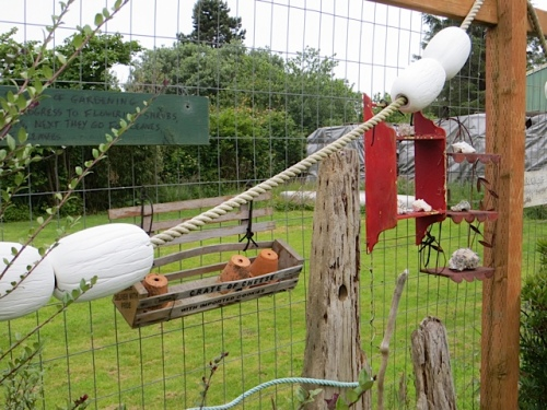 I spent some time hanging up fence decor instead of weeding...