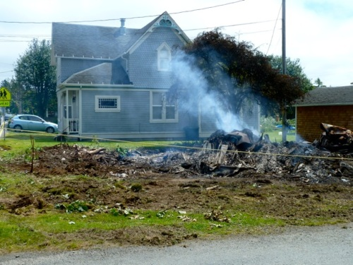 The crew had tried to save a maple tree; I can see here that it must have gotten too scorched.  It is gone; the hawthorne still stands.
