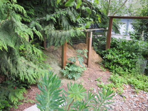 behind the arbour, a compost work area