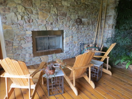 with a fireplace to one side of the lower level