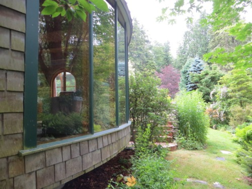 the living room windows with garden view