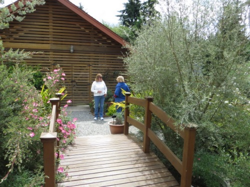 from the front of the house, a bridge to the garden behind the garage