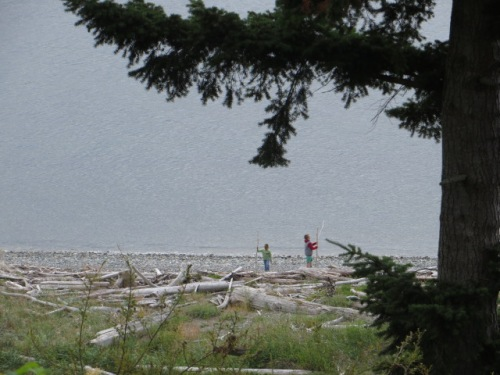 The view includes beach walkers.