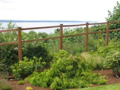 The transparent deer fence, very similar to ours that preserves our view of the Port of Ilwaco.