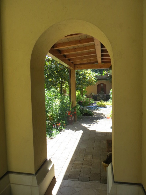 an arch leading to the back of the house