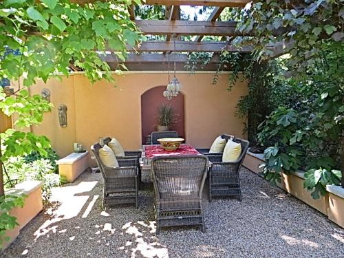 outdoor fireplace under an arbour lattice