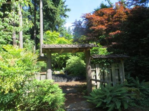We enter through a rustic gate.