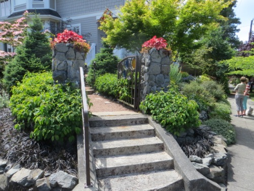Steps to the garden at the corner of the lot
