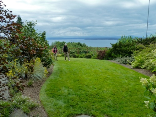 Allan's photo:  the owner and a guest stroll the lawn