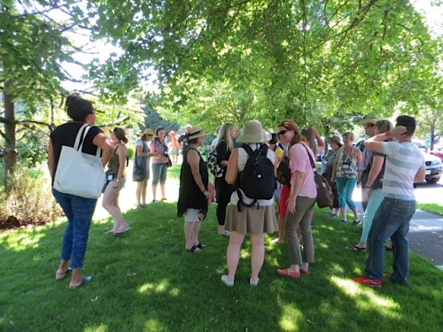 bloggers gathered in the shade by the front courtyard