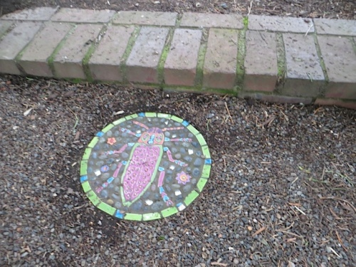 one of the several little tiles throughout the garden