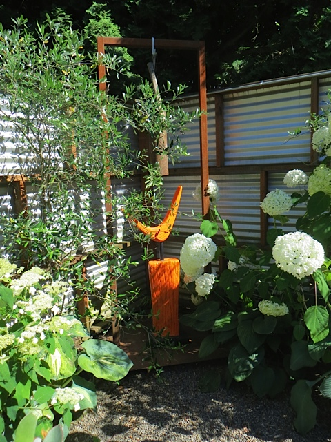 corner of back yard; I'm fond of fences made of metal like that.